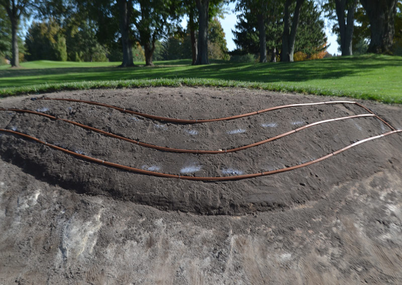 Drip irrigation golf bunker